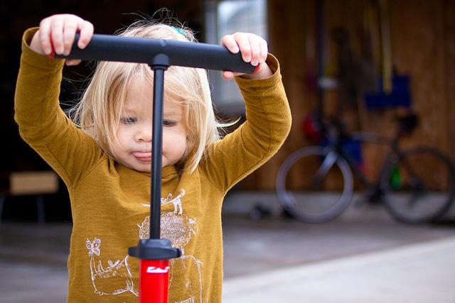 Assistant bike tire pumper-uper in training